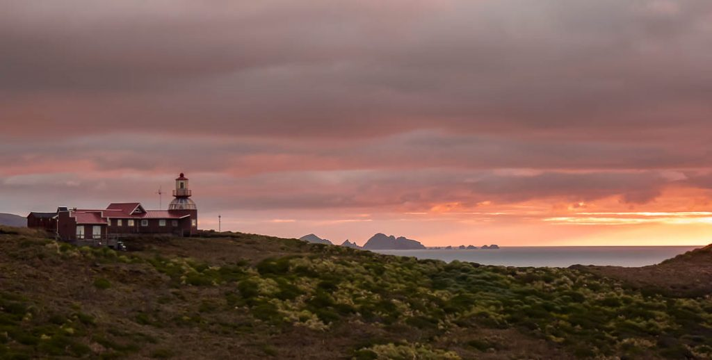Sunset at the lighthouse on Cape Horn. The southern tip of South America. Next stop Antarctica