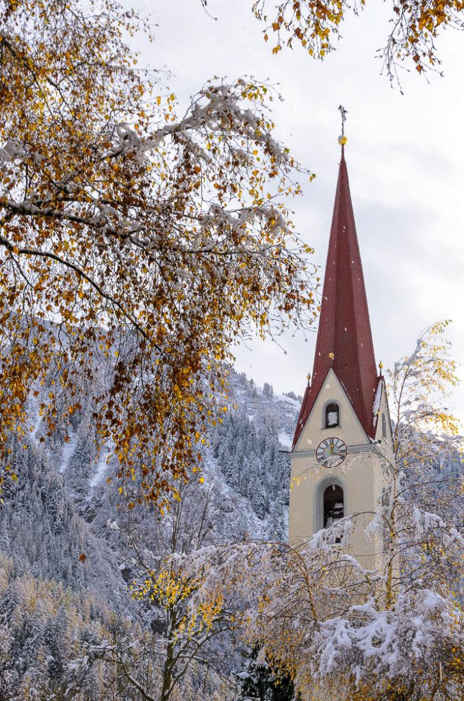 The church tower in Elmen, Tirol under the first fall of snow of the winter.