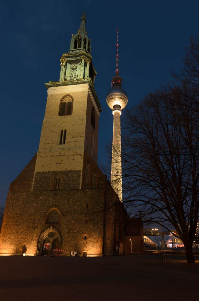 The TV Tower in Berlin with the Marienkirche in the foreground.