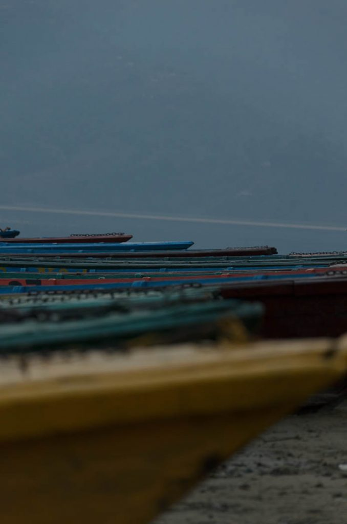 Fishing boats moored for the evening in Pokhara, Nepal.