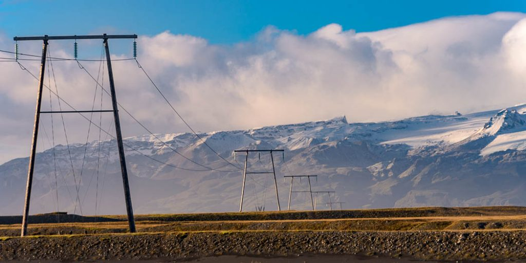 Most of Iceland's electricty production is from Geothermal Power. However it then has to be brought to the population centres by massive power lines.