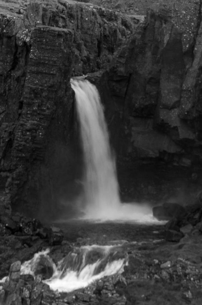 Waterfall among the volcanic rocks of Iceland