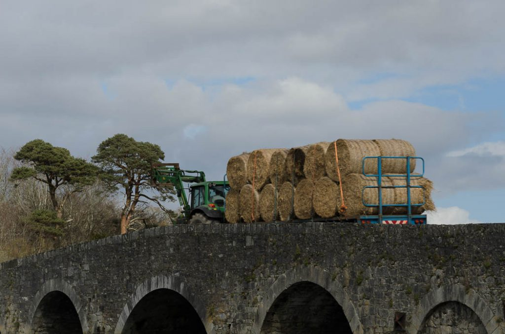 Hay bales being collected during the summer.