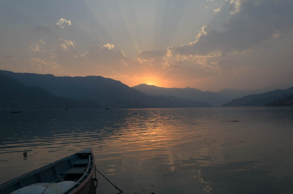 Sunset over the lake beside Pokhara, a backpacker's paradise and trekking centre in Nepal.