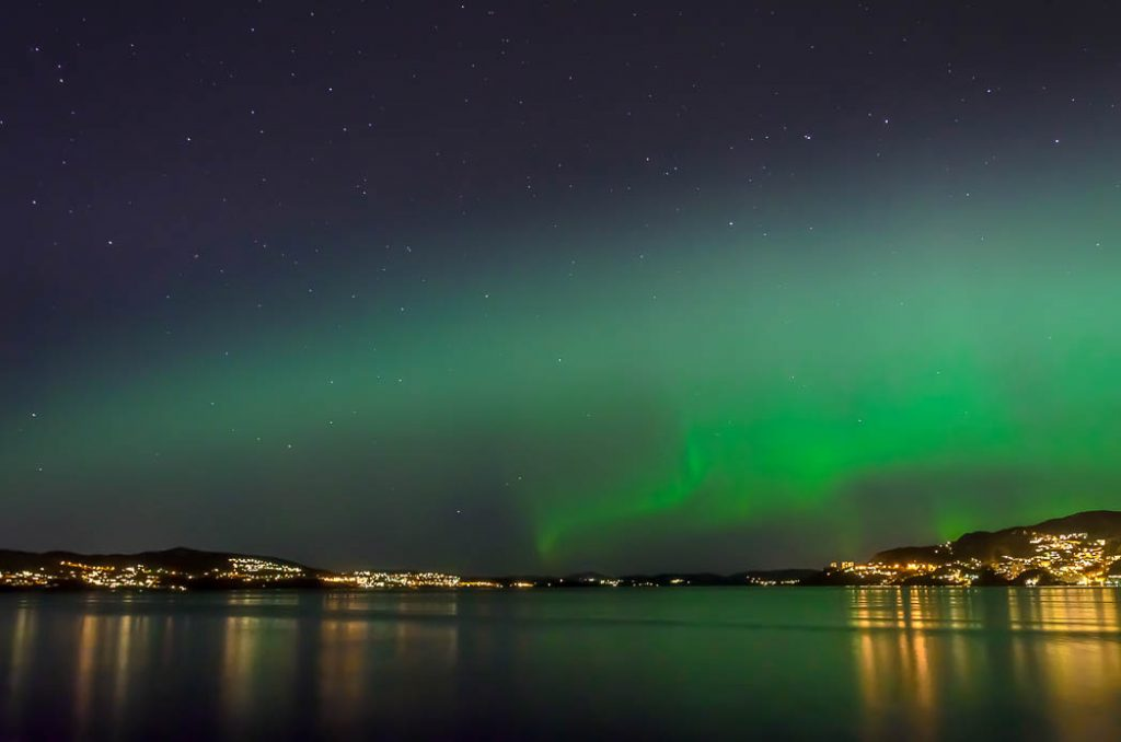 The Northern Lights have to be very bright to be seen so far south and even brighter to be seen in a city. This was in Bergen Norway.