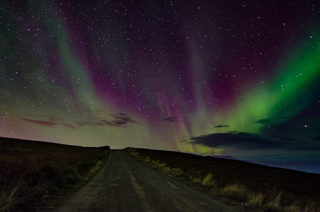 Driving up a dirt road will often get you out from the city lights in Iceland. However you don't always get a clear sky. That takes luck.