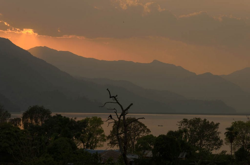 The backpacker's town of Pokhara is nicely situated on the East side of the reservoir to allow for sundowners in the local cafes.