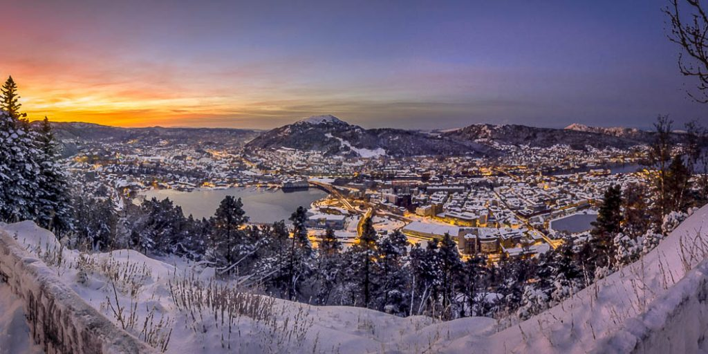 Sunrise over the city of Bergen on a snowy winter morning. View is from the top of Mt Fløien.