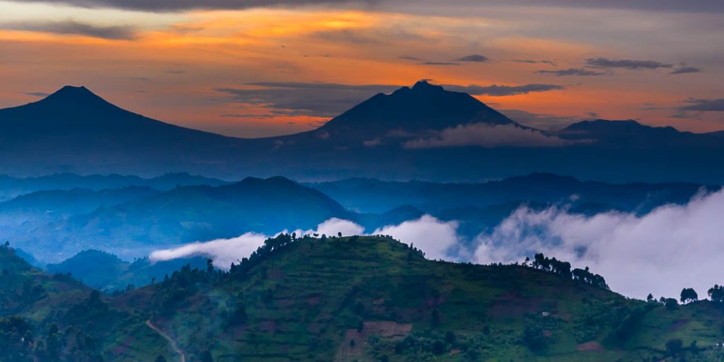 A view from the Nkoringo area of the Bwindi Forest of Uganda into the volcanoes of the Virunga Mountains. Later in the evening the glow of Niaragongo Volcano was visible.